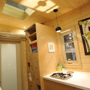 TINY HOUSE PLANS – CONTEMPORARY DRAGONFLY-20 – KITCHEN & BATHROOM DOOR